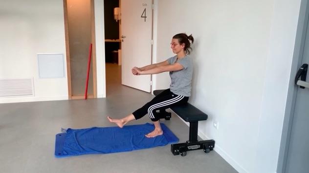 position assise quadriceps en excentrique renforcement du genou